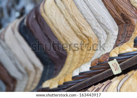 cowboy mexican leather boots on display - stock photo