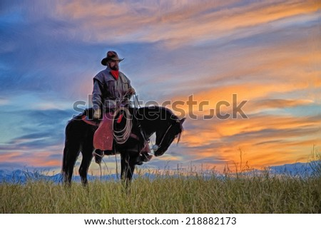 Cowboy on horseback against vibrant dawn sky - stock photo
