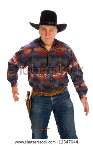 Cowboy reaching for his gun. - stock photo