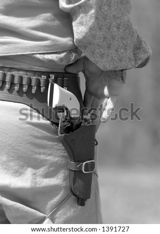 Cowboy Ready to Draw Pistol from Holster - stock photo