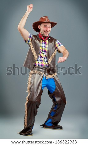 cowboy rides and smiled - stock photo