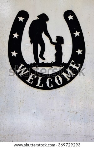 Cowboy style, vintage welcome sign.  - stock photo
