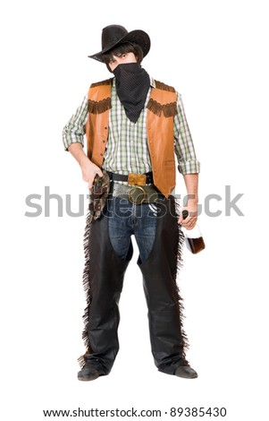 Cowboy with a bottle of whiskey in hand - stock photo