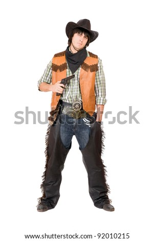 Cowboy with a gun in hand. Isolated on white - stock photo