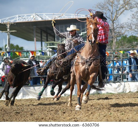 Cowboys with Lassos - stock photo