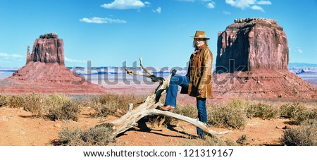 cowgirl at Monument Valley, western movie style - stock photo