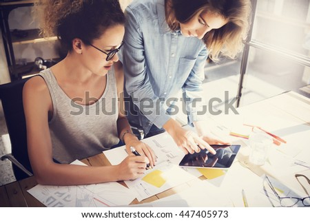 Coworkers Work Process Modern Office Loft.Young Professionals Making Great Decision New Creative Idea.Business Team Working Startup.Digital Tablet Wood Table.Analyze Market Reports.Blurred.Film Effect - stock photo