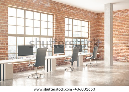 Coworking office interior with computers, concrete floor, red brick walls, columns and windows with city view. 3D Rendering - stock photo