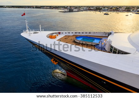 COZUMEL, MEXICO - JAN 26 2016:  Disney Magic cruise ship  at Cozumel port.   Over 3500 passengers  visited that beautiful tropical island. The economy of Cozumel is based on tourism. - stock photo