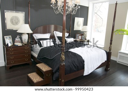 cozy bedroom with a queen size bed in the American style - stock photo