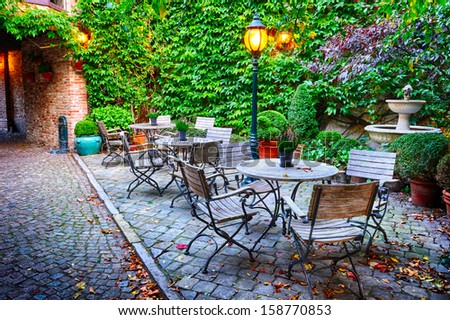 Cozy cafe terrace in Bruges, Belgium - stock photo