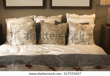 Cozy comfortable bedding and cushions - stock photo