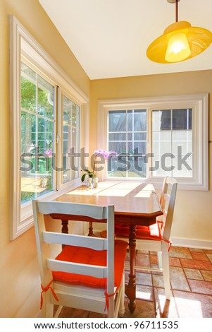 Cozy dining table breakfast area in the small kitchen. - stock photo
