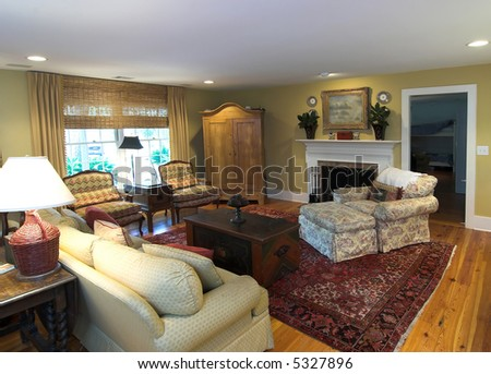 cozy furnished livingroom with fireplace - stock photo
