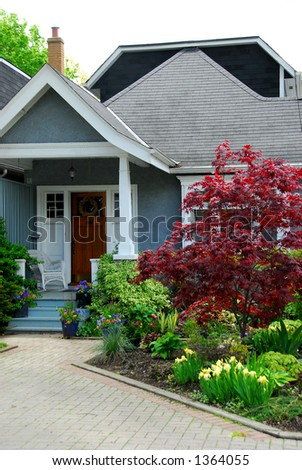Cozy home with beautuful landscaping - stock photo