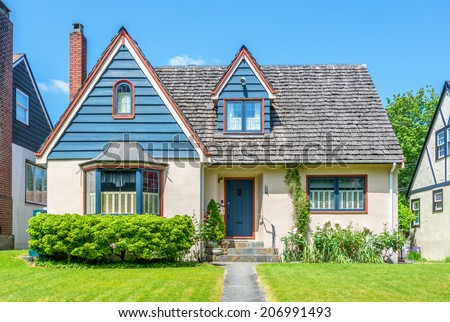 Cozy house with beautiful landscaping on a sunny day in Vancouver, Canada - stock photo