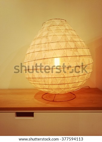 Cozy lamp giving warm yellow light. Interior design. - stock photo