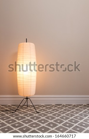 Cozy lamp in an empty room, with copy space. - stock photo