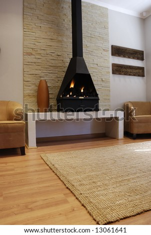 Cozy Living Room with a modern gas fireplace - stock photo