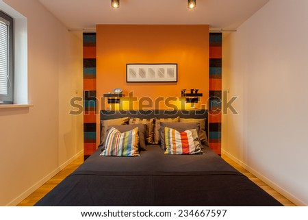 Cozy modern bedroom interior for young couple - stock photo
