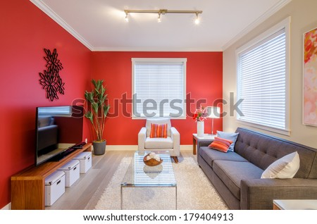 Cozy modern red living room interior design - stock photo