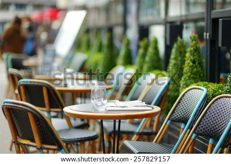 Cozy outdoor cafe in Paris, France - stock photo