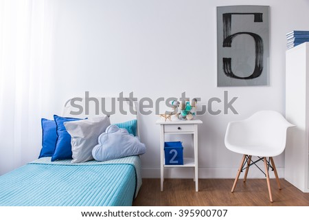 Cozy relax space with single bed in modern designed boy's room - stock photo