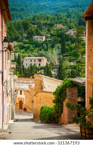 cozy street of the mountain village Deia in Mallorca, Spain - stock photo