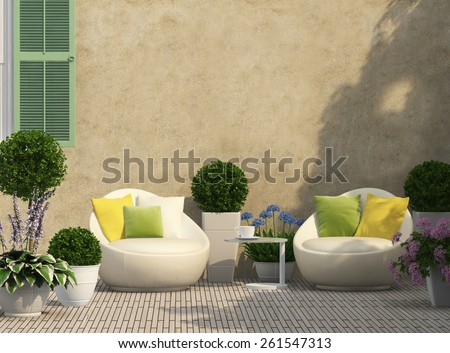 Cozy terrace in the garden with flowers - stock photo