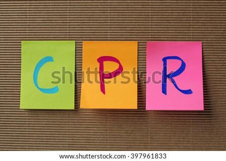 CPR (Cardiopulmonary Resuscitation) acronym on colorful sticky notes - stock photo