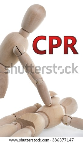 CPR or First Air is being performed with two wooden characters. - stock photo