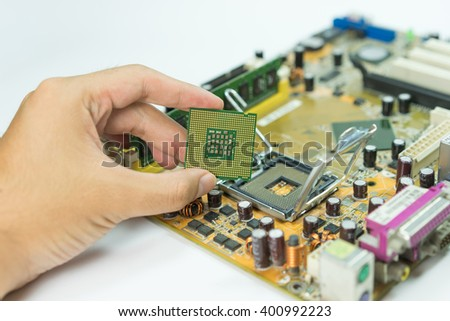 CPU in hand from motherboard socket, selective focus - stock photo