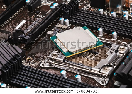 CPU socket and processor on the motherboard. focus on top of CPU - stock photo