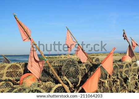 Crab and Lobster Traps with Flags - stock photo