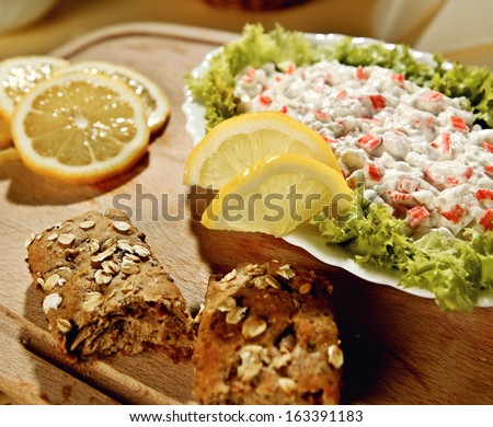 Crab dip with a lemon and fresh bread - stock photo
