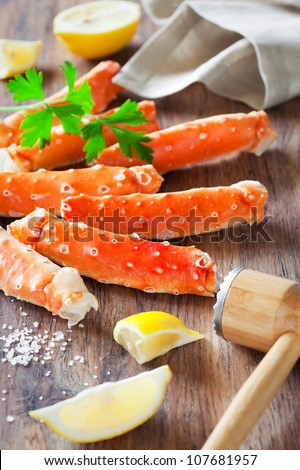 Crab legs on wooden table, selective focus - stock photo