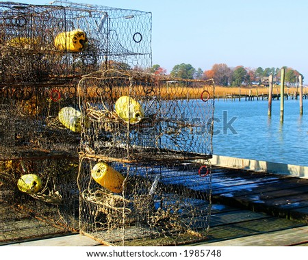 Crab pots stacked together on pier along the York River in Virginia - stock photo