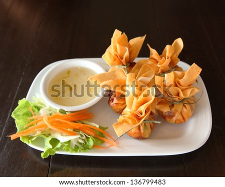 Crab rangoon with sauce - stock photo