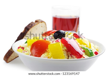 Crab salad with rice and vegetables on white - stock photo