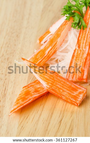 Crab Stick on wooden background. - stock photo
