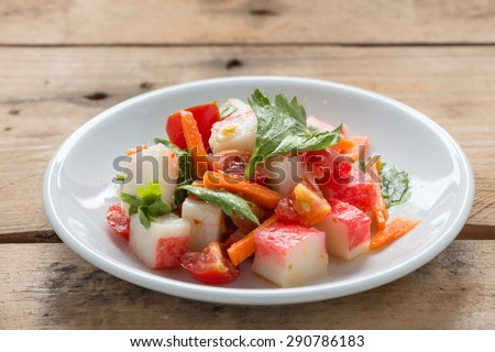 Crab stick spicy salad with vegetable. - stock photo