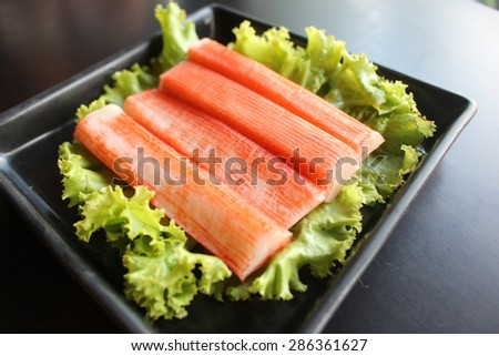 crab stick with lettuce - stock photo
