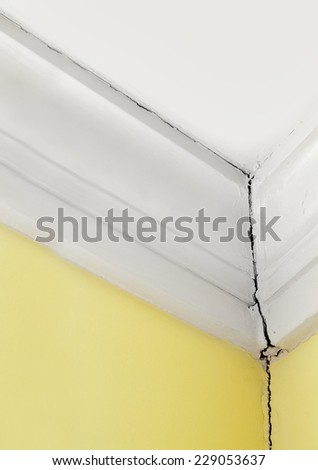 crack in a house wall and ceiling - stock photo