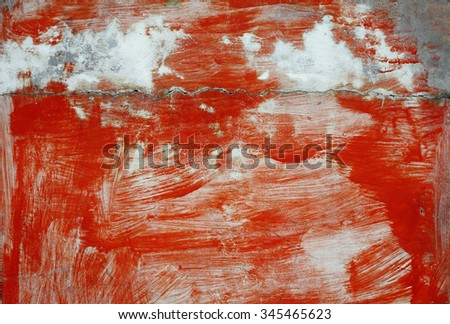 Crack line on the surface of a rugged red concrete wall.  - stock photo