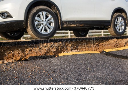 Crack of asphalt road after earthquake - stock photo