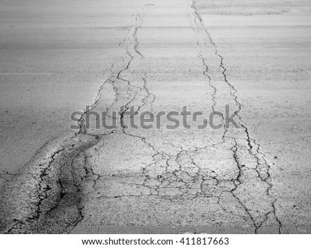 crack on asphalt road texture - stock photo