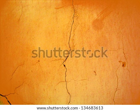 Crack on concrete brown wall - stock photo
