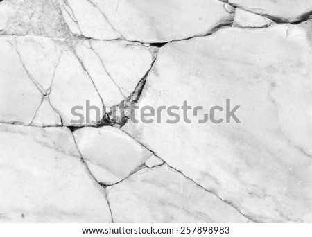 crack on marble background from a giant white rock - stock photo