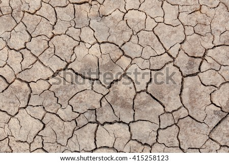 Crack soil on dry season, Global worming effect, Thailand - stock photo