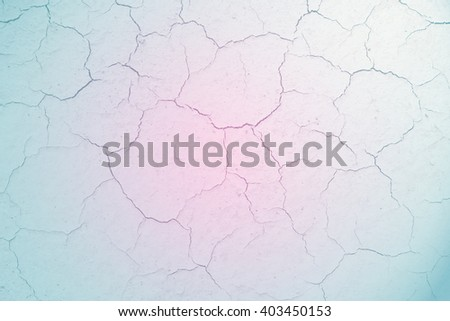 Crack soil texture with a pastel colored gradient. - stock photo